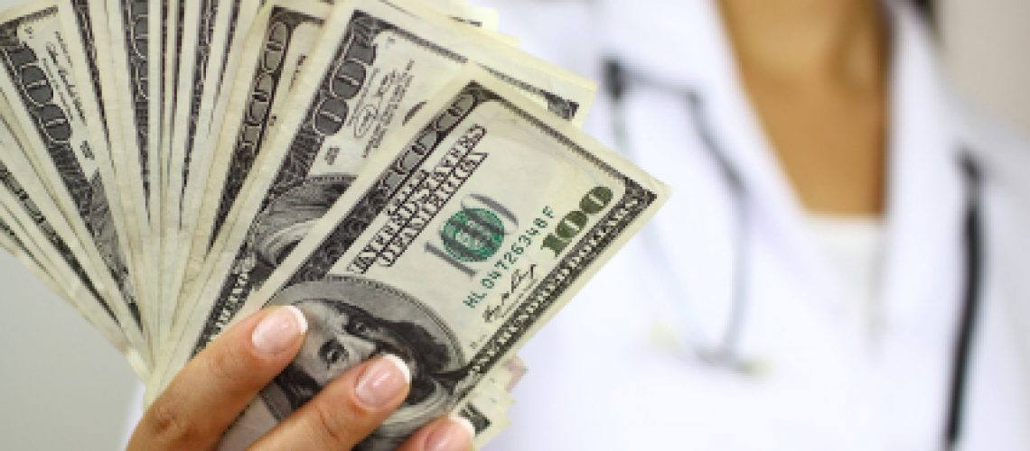 doctor-holding-money